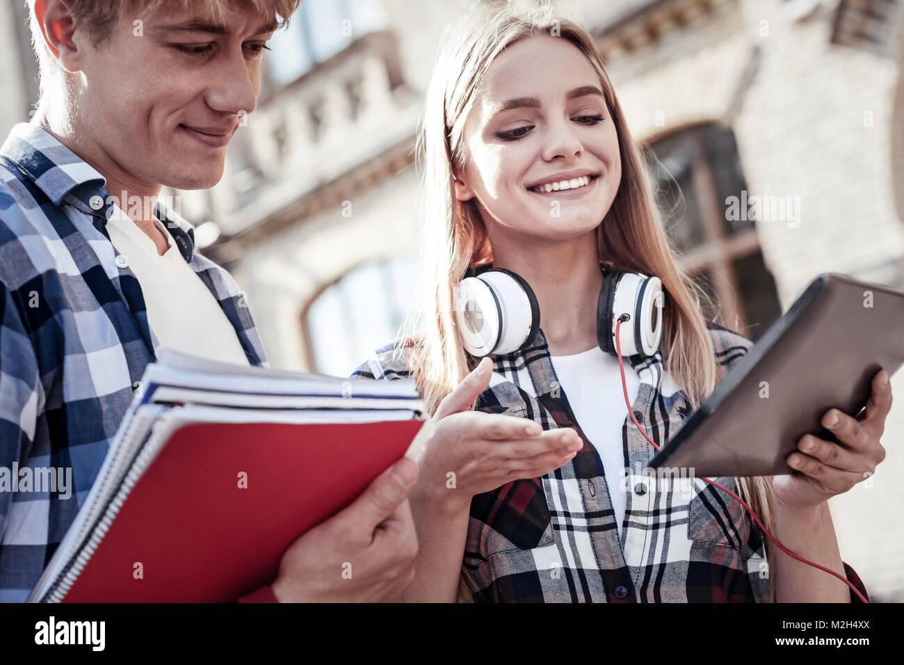 Joyful positive students talking to each other - Stock Image