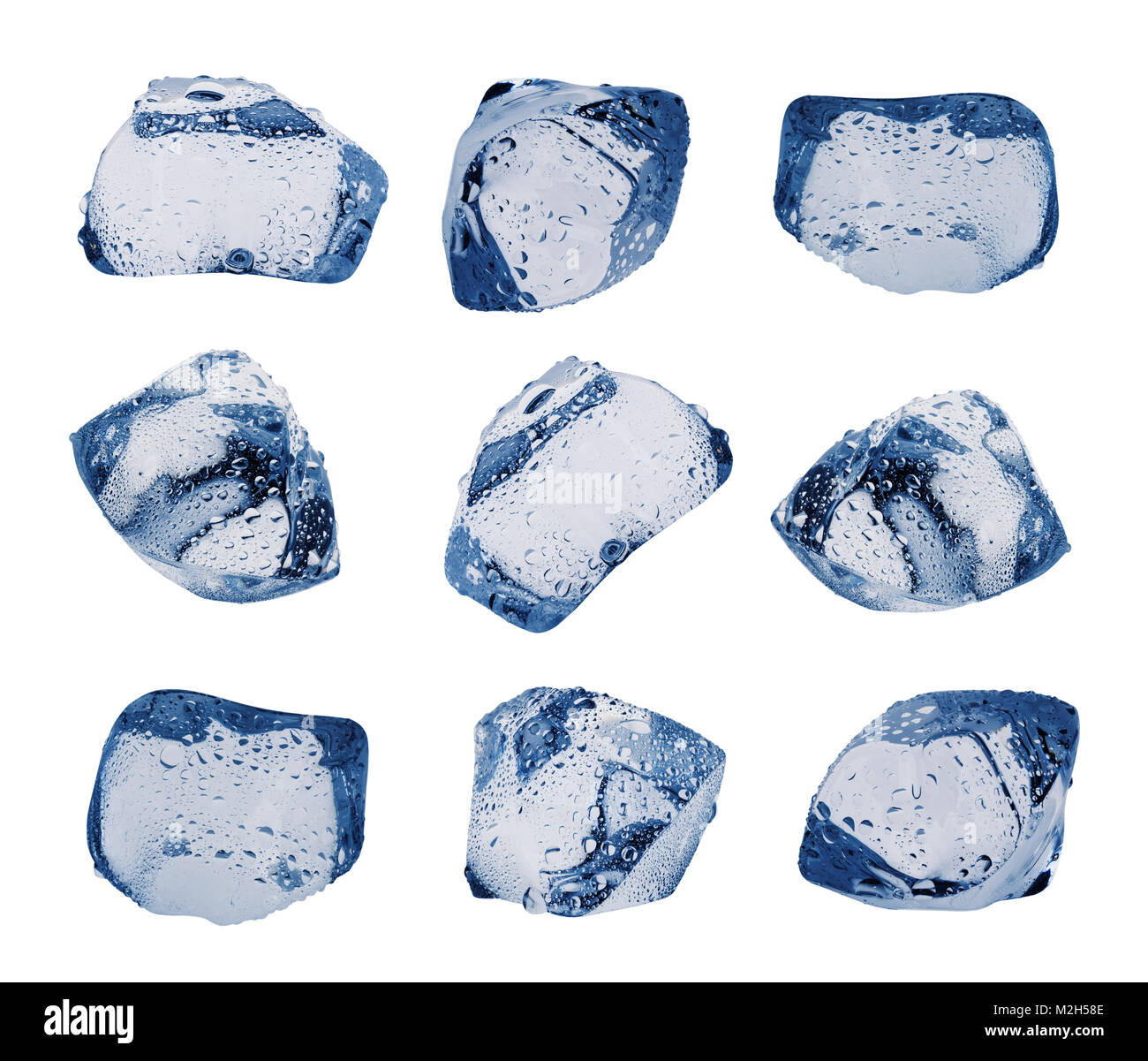 Large variety of ice cubes with droplets isolated on white background. Set. Toning in blue. - Stock Image