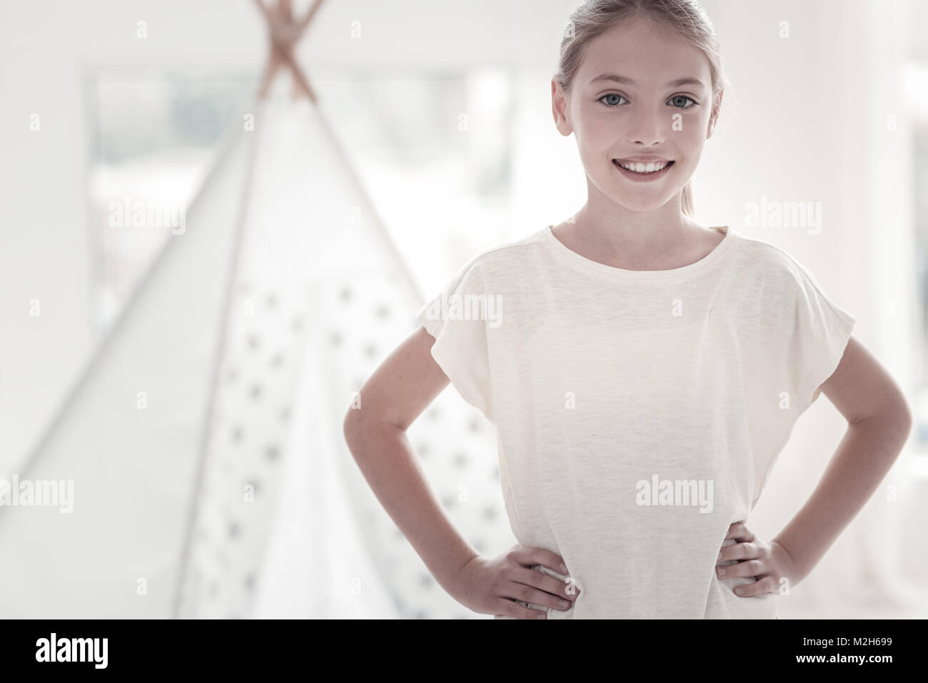 Beautiful girl smiling and wearing a t-shirt - Stock Image