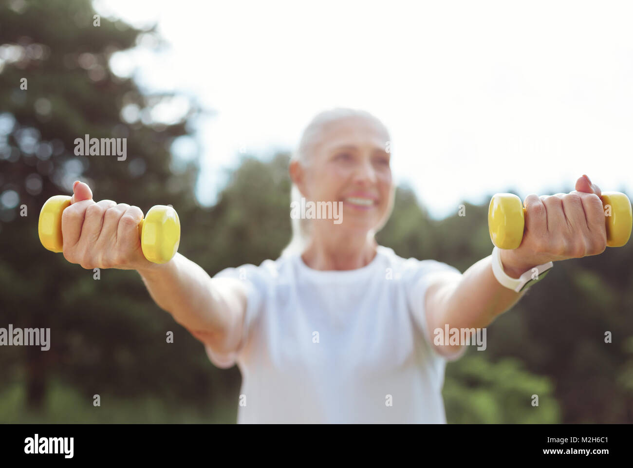 Selective focus of yellow dumbbells - Stock Image