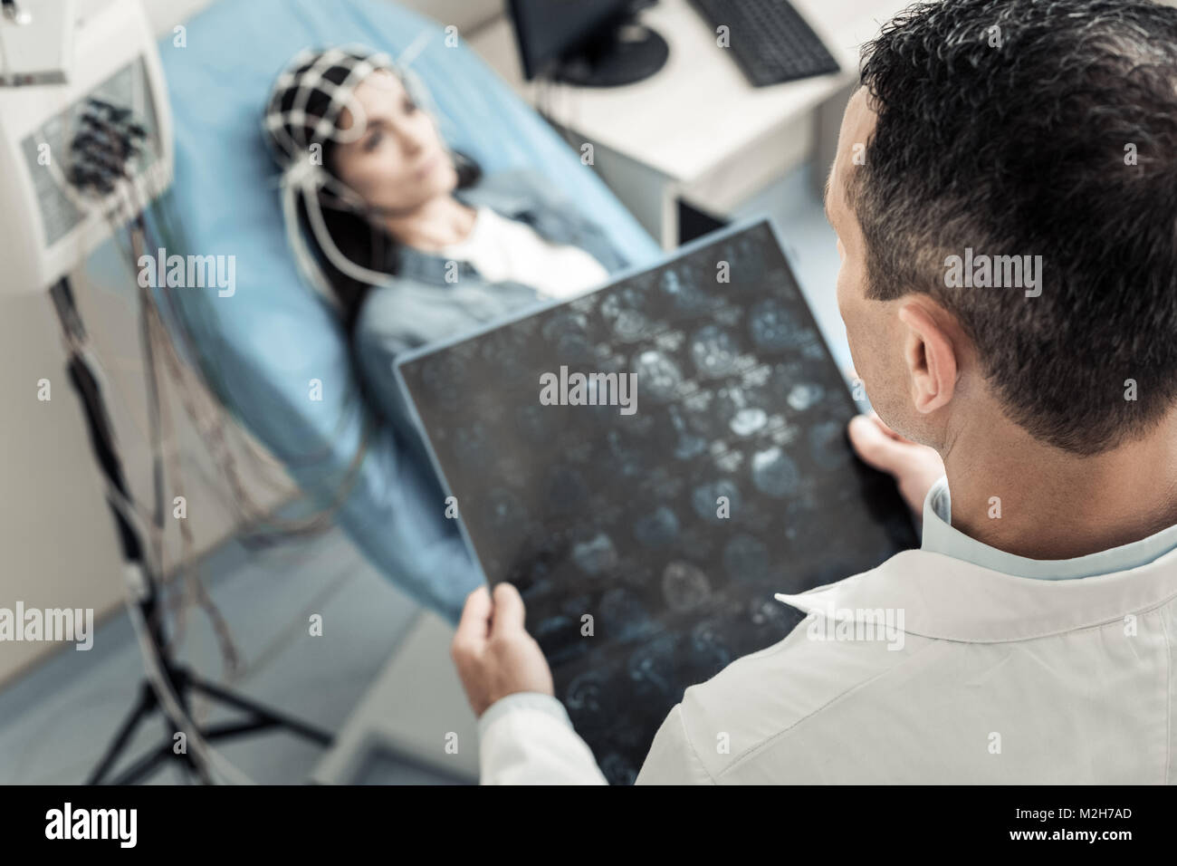 Professional experienced doctor putting a diagnosis - Stock Image