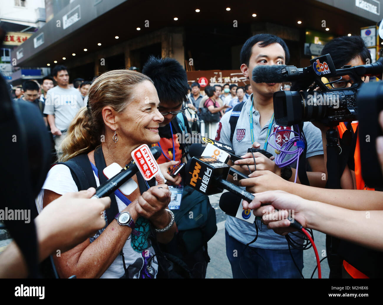 Getty Images photographer Paula Bronstein is taken away by the Hong Kong Police after she climbed on a car to take - Stock Image
