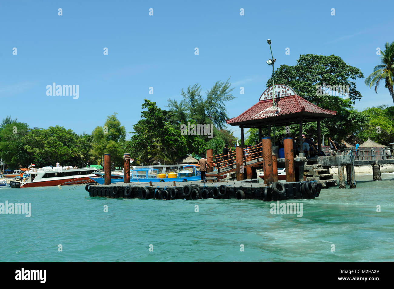 Floating dock jetty pier Gili Air Gili islands Lombok Indonesia - Stock Image