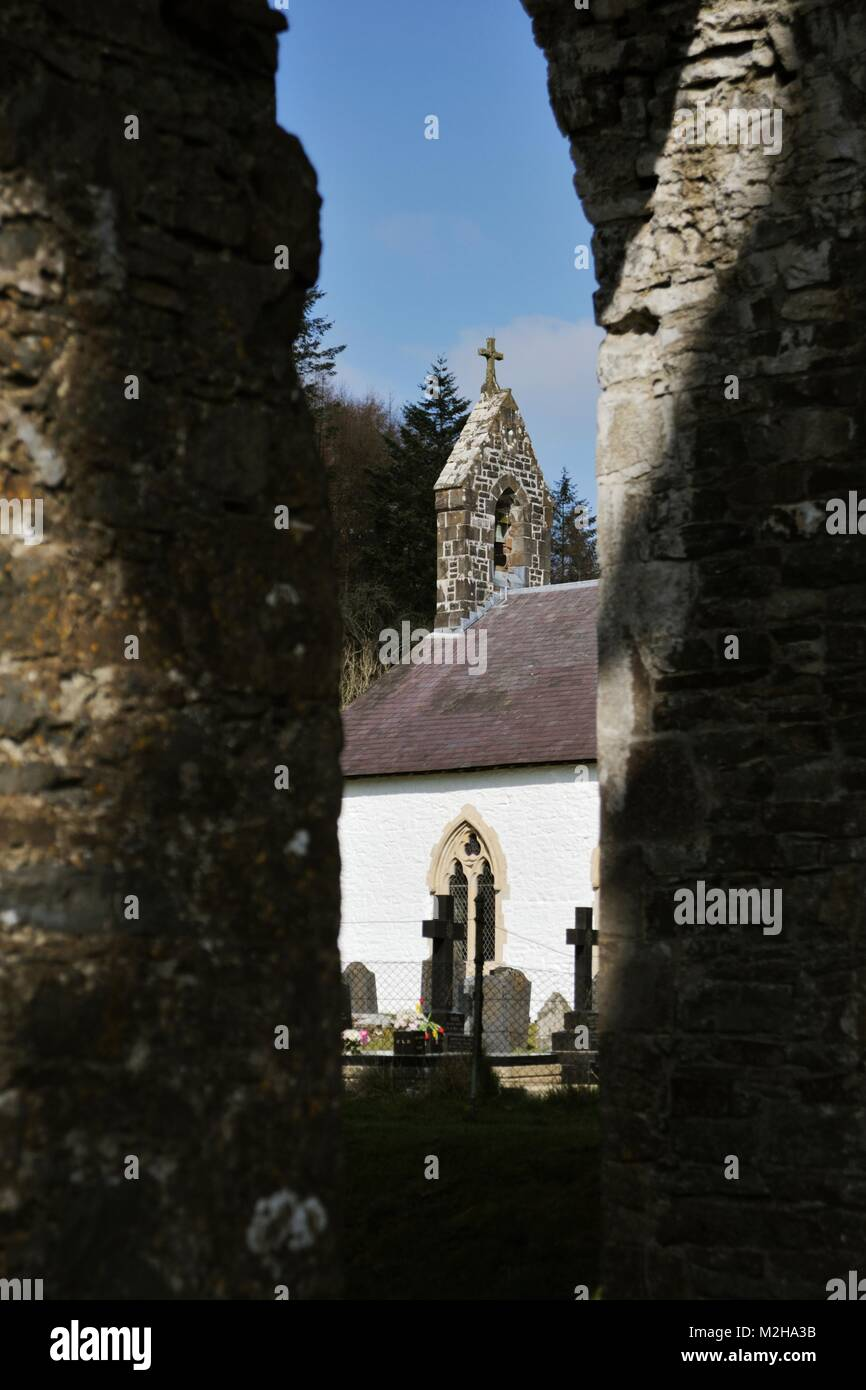 Talyllychau, Talley Abbey ruins framing St Michaels Church, built from the stone of the ruined abbey in the 18th - Stock Image
