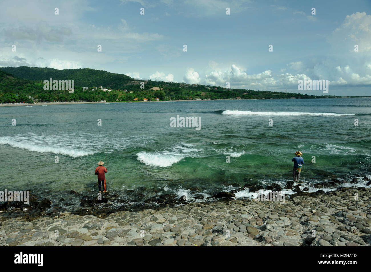 Fishermen on surf beach, Lombok, Indonesia Stock Photo