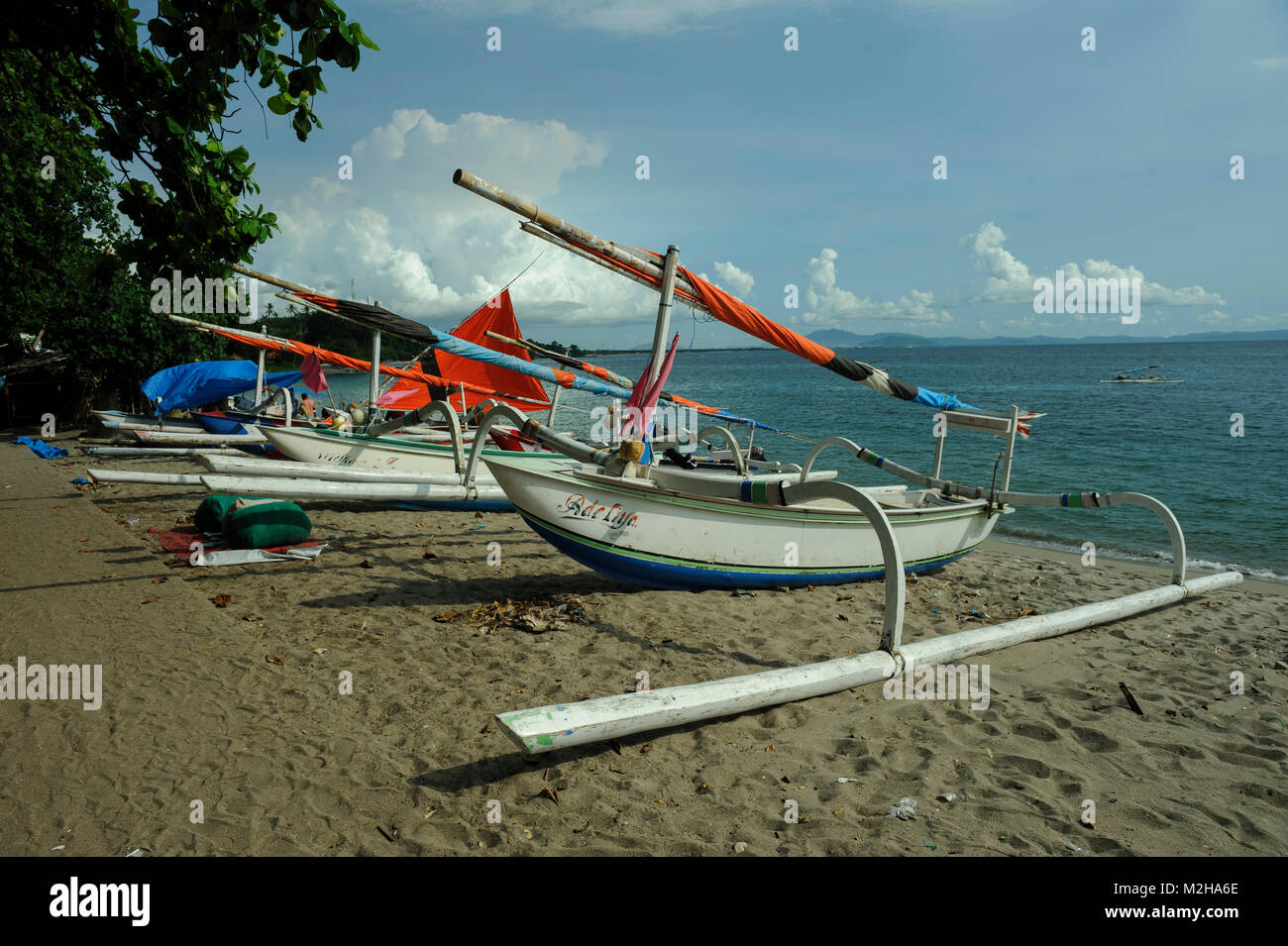 traditional fishing boats Jukung on beach in Lombok, Indonesia Stock Photo