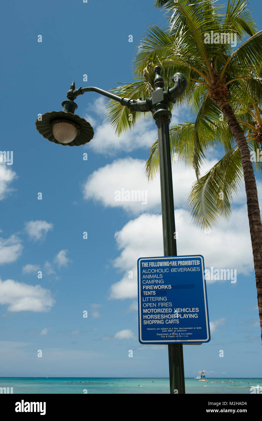 "Sign with list of prohibitied activities, including ""horseshoe playing"". Waikiki, Honolulu, Hawaii, USA Stock Photo"