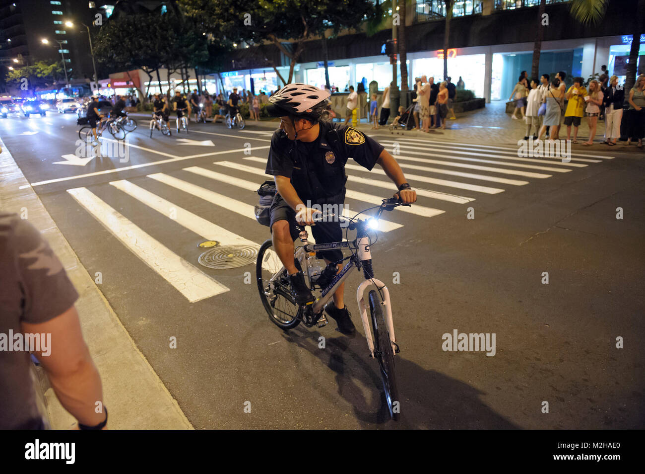 Policeman on bicycle bike patrol, Waikiki, Honolulu, Hawaii Stock Photo