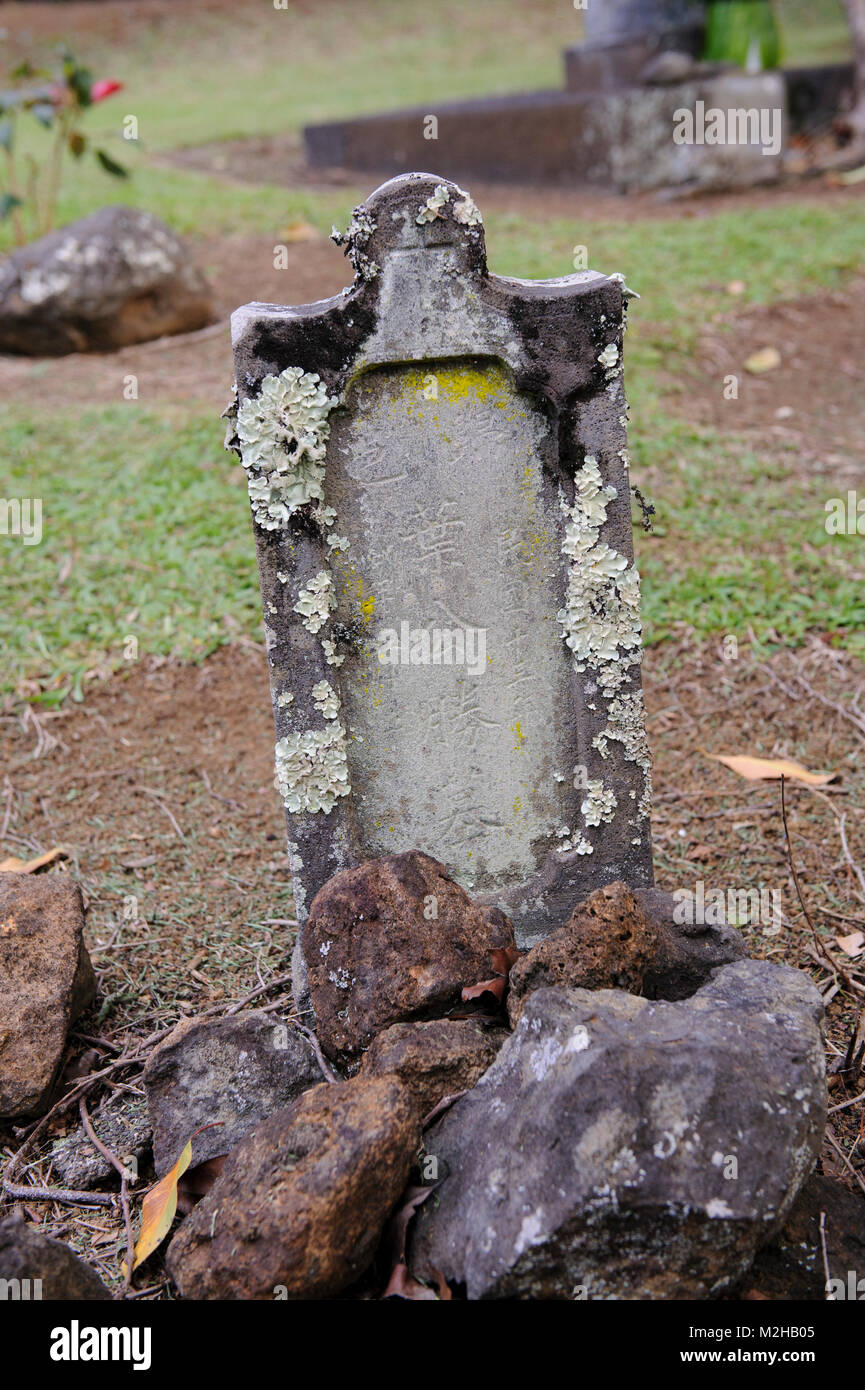 Grave and tombstone headstone with carved Chinese characters, The Kohala Tong Wo Society cemetery, Kohala, Big Island, Stock Photo