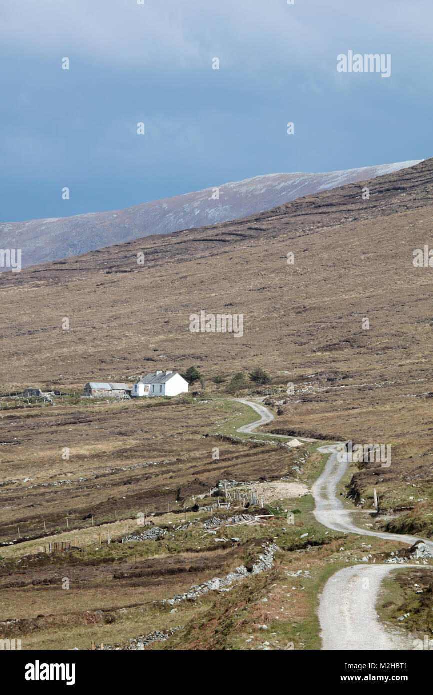 Remote cottage on boggy hillside, Achill Island, County Mayo, Ireland. - Stock Image