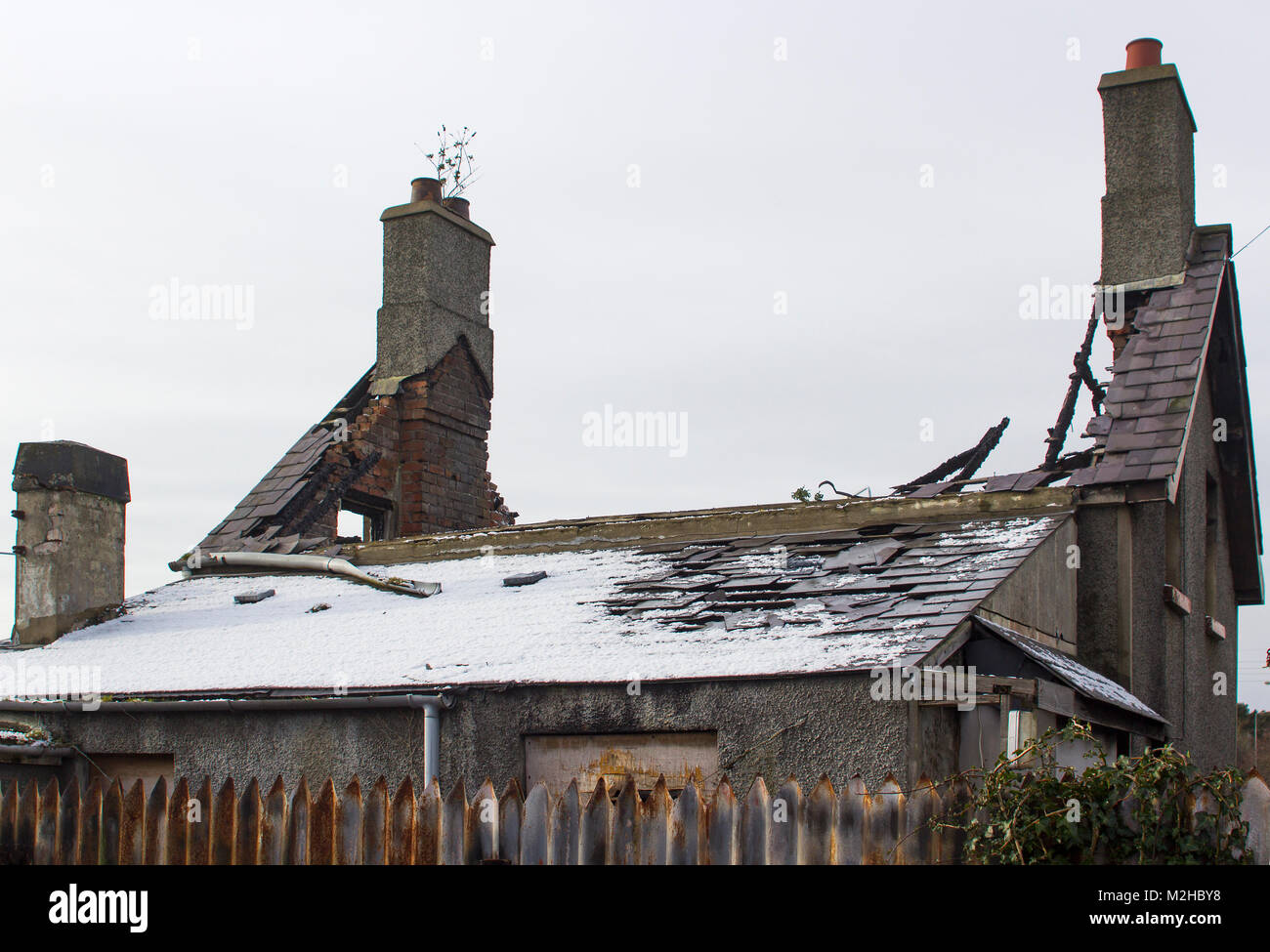 A small detached bungalow totally destroyed by a fire in Bangor Northern Ireland and needing to be demolished - Stock Image