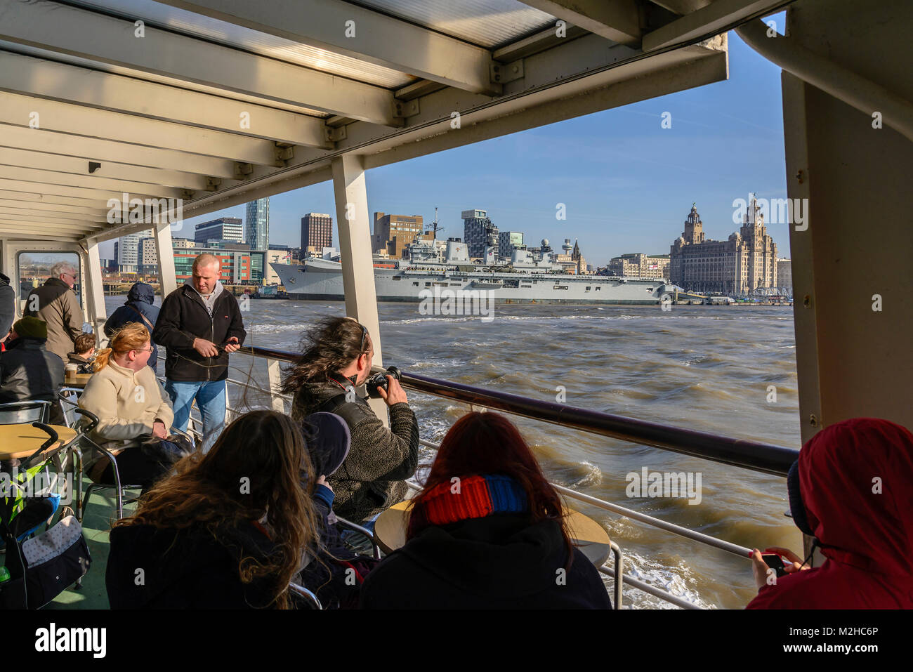 Onboard Mersey ferry pix of crowds. - Stock Image
