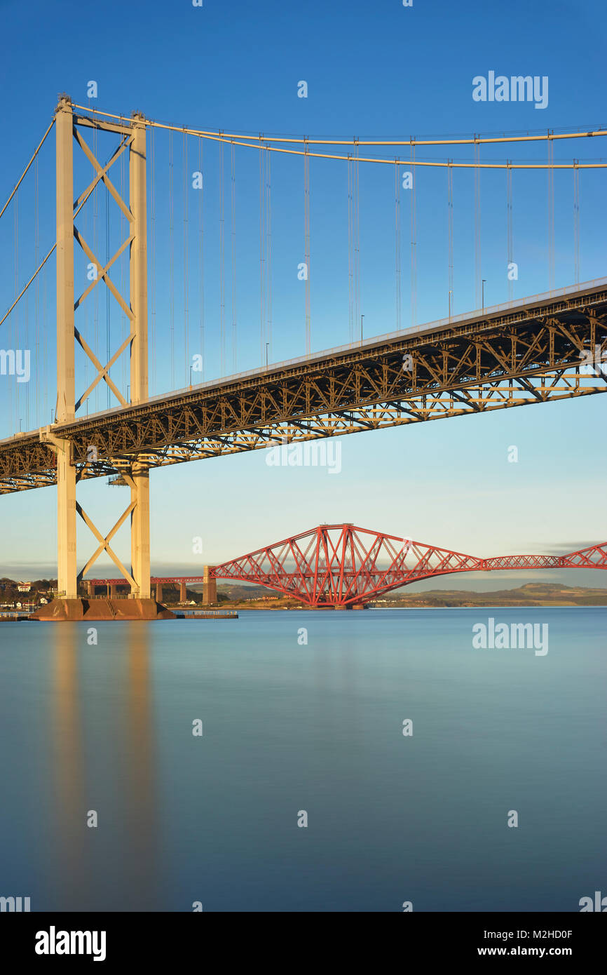 Forth Road Bridge and the Forth Rail Bridge from Port Edgar, South Queensferry, Edinburgh, Scotland Stock Photo