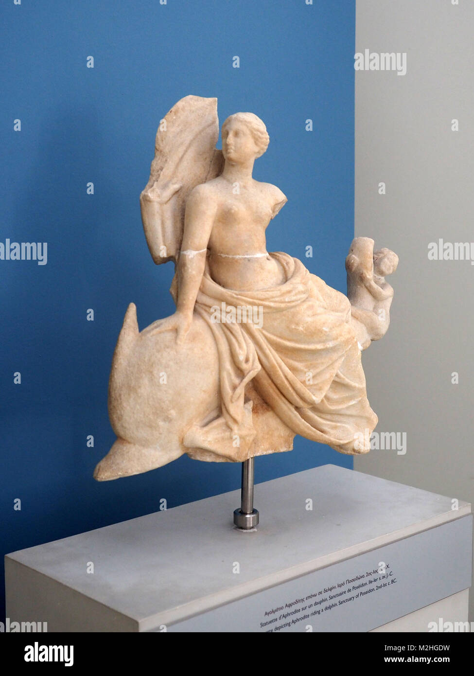 Classic statue of a woman on a dolphin, at the Archaeological Museum of Samothrace, Samothrace Island, Greece - Stock Image