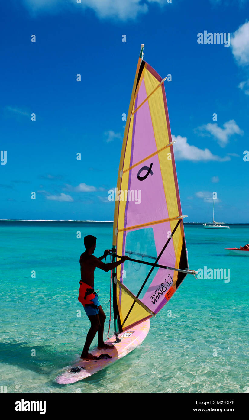 Surfer at Le Morne Plage, Mauritius - Stock Image