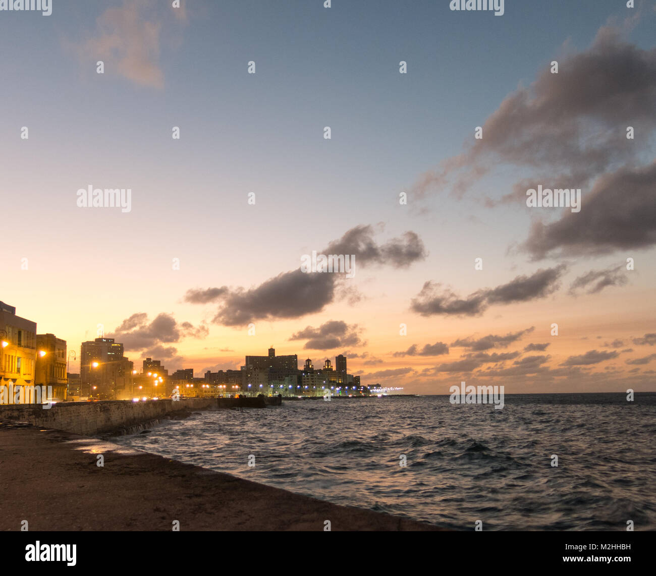 Sunset at Malecon, the famous Havana promenades where Habaneros, lovers and most of all individual fishermen meet, - Stock Image