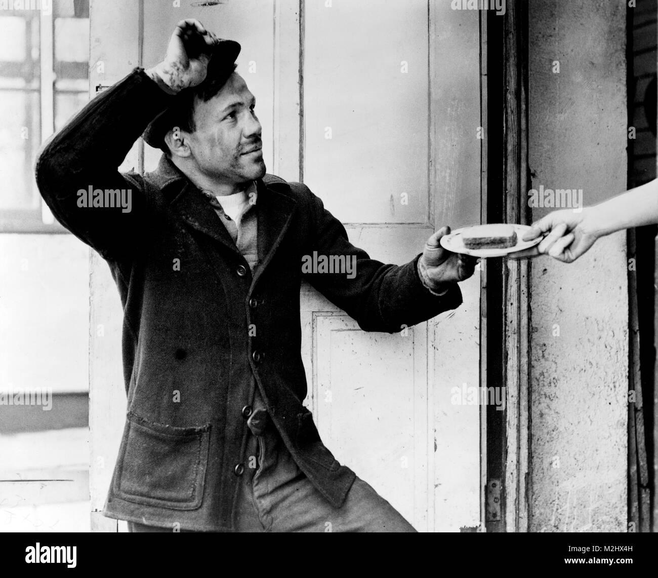 Hobo Accepts Sandwich, 1935 - Stock Image