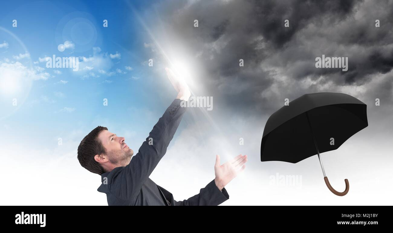 Man blocking Grey sky and blue sky weather change surreal transition and umbrella Stock Photo