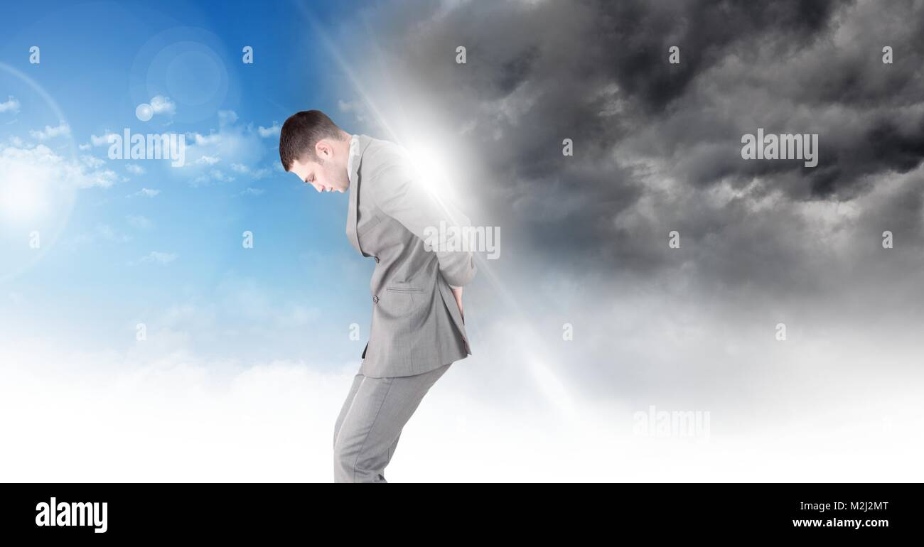 Man blocking Grey sky and blue sky weather change surreal transition Stock Photo