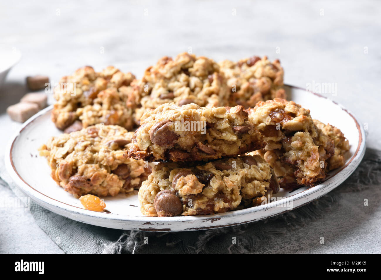 Healthy oatmeal cookies on plate, close up view - Stock Image