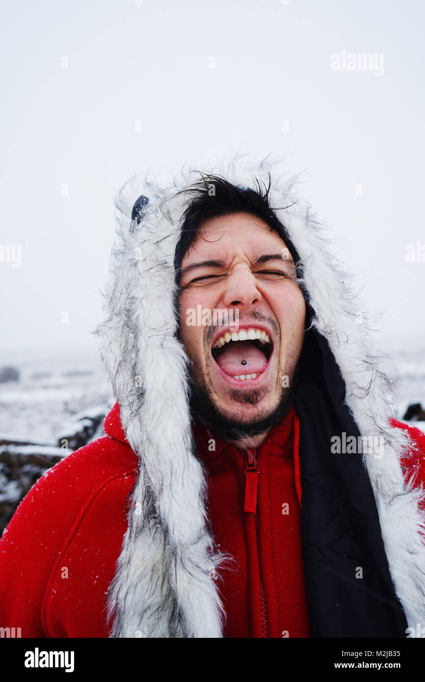 Young man enjoying a snowy day - Stock Image