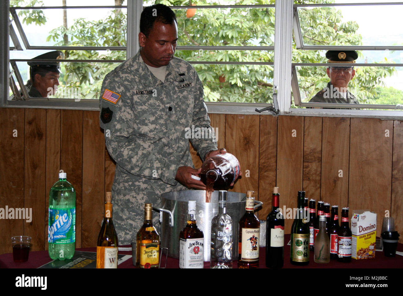 Lt. Col. Armstrong adds an ingredient to the grog bowl during the U.S. Army's 235th birthday celebration in - Stock Image