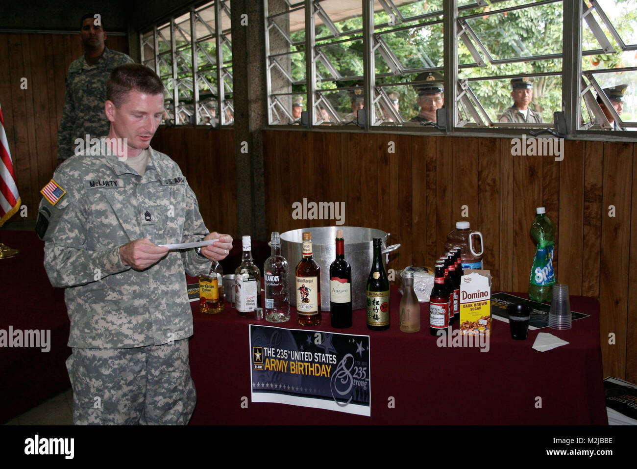 Sgt. 1st Class Samuel Mclarty prepares to add an ingredient to the grog bowl during the U.S. Army's 235th birthday - Stock Image
