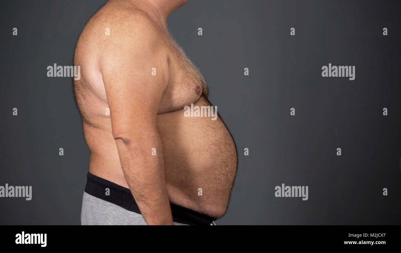 Unhealthy man with fat tummy, unhealthy food addiction result, health problems, stock footage - Stock Image
