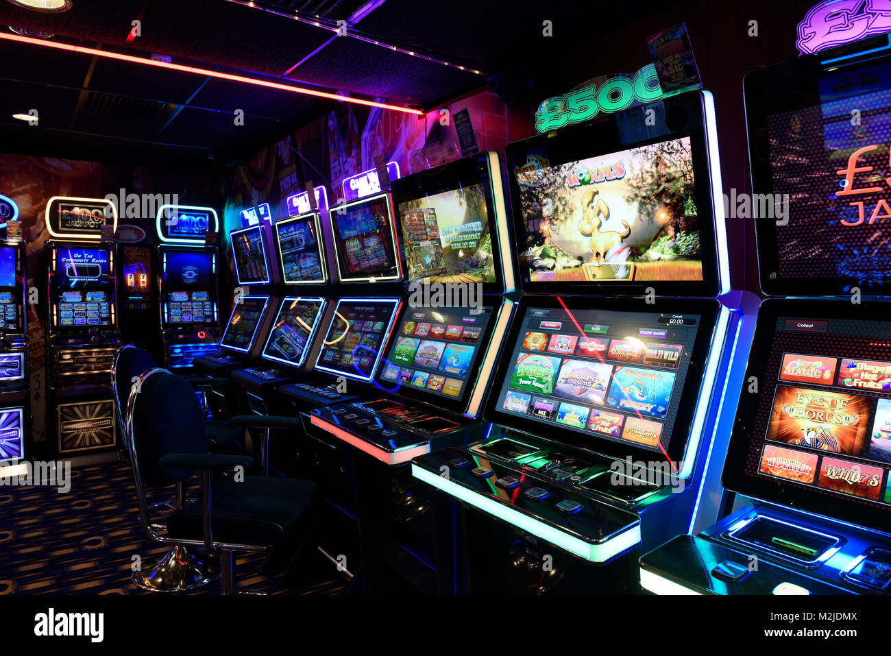 Fruit machines, Fixed Odds Betting Terminals, gambling machines, slot machines in amusement arcade UK - Stock Image