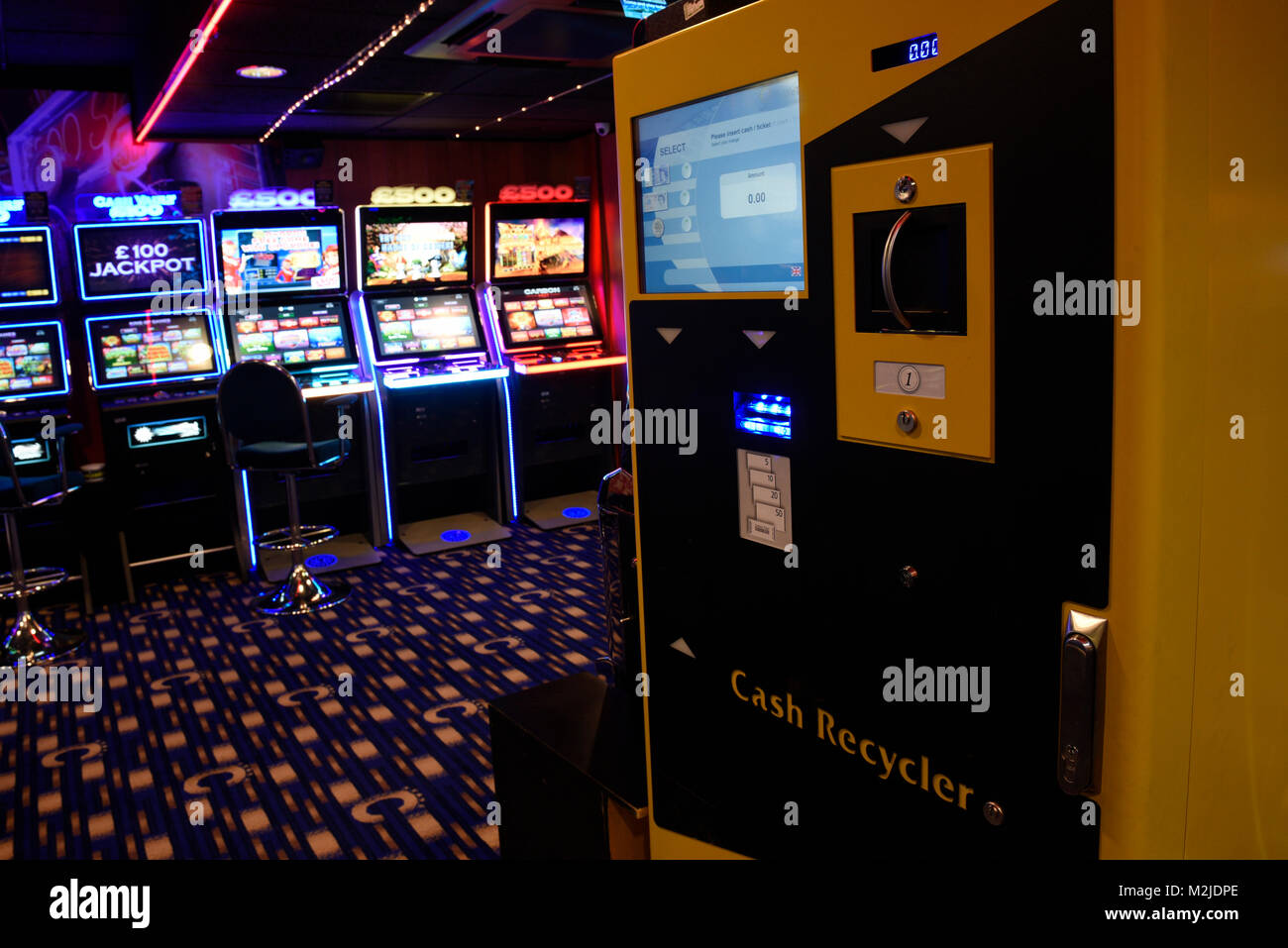 Fruit machines, Fixed Odds Betting Terminals, gambling machines, slot machines in amusement arcade UK Stock Photo