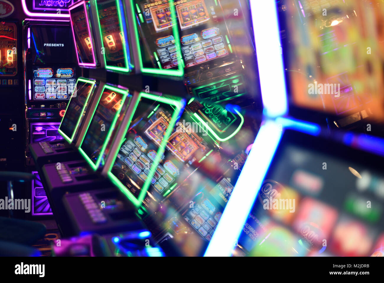 Fruit machines, gambling machines, slot machines concept, abstract in amusement arcade UK - Stock Image