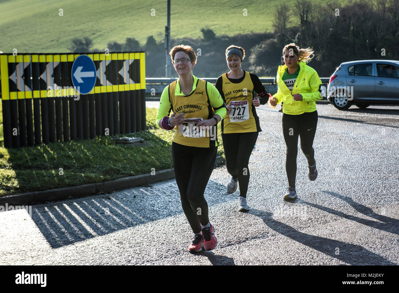 Runners competing in a road race in Newquay Cornwall. - Stock Image
