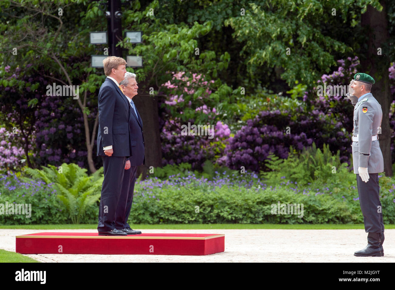 Welcome Their Majesties King Willem-Alexander and Queen Maxima of the Netherlands with military honours by the German Stock Photo