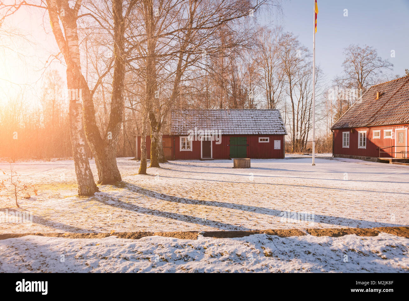 Traditional swedish farm buildings. in red wood. - Stock Image