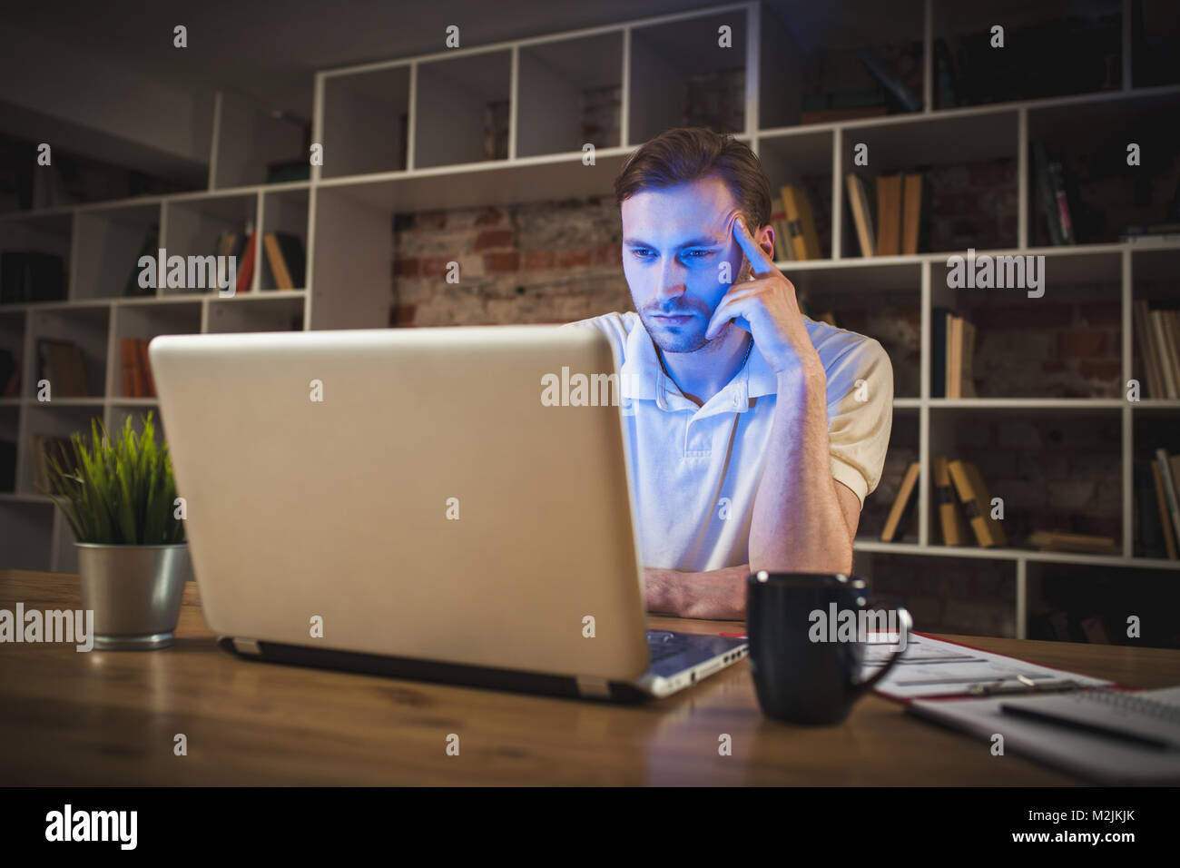 Young man with a laptop - Stock Image