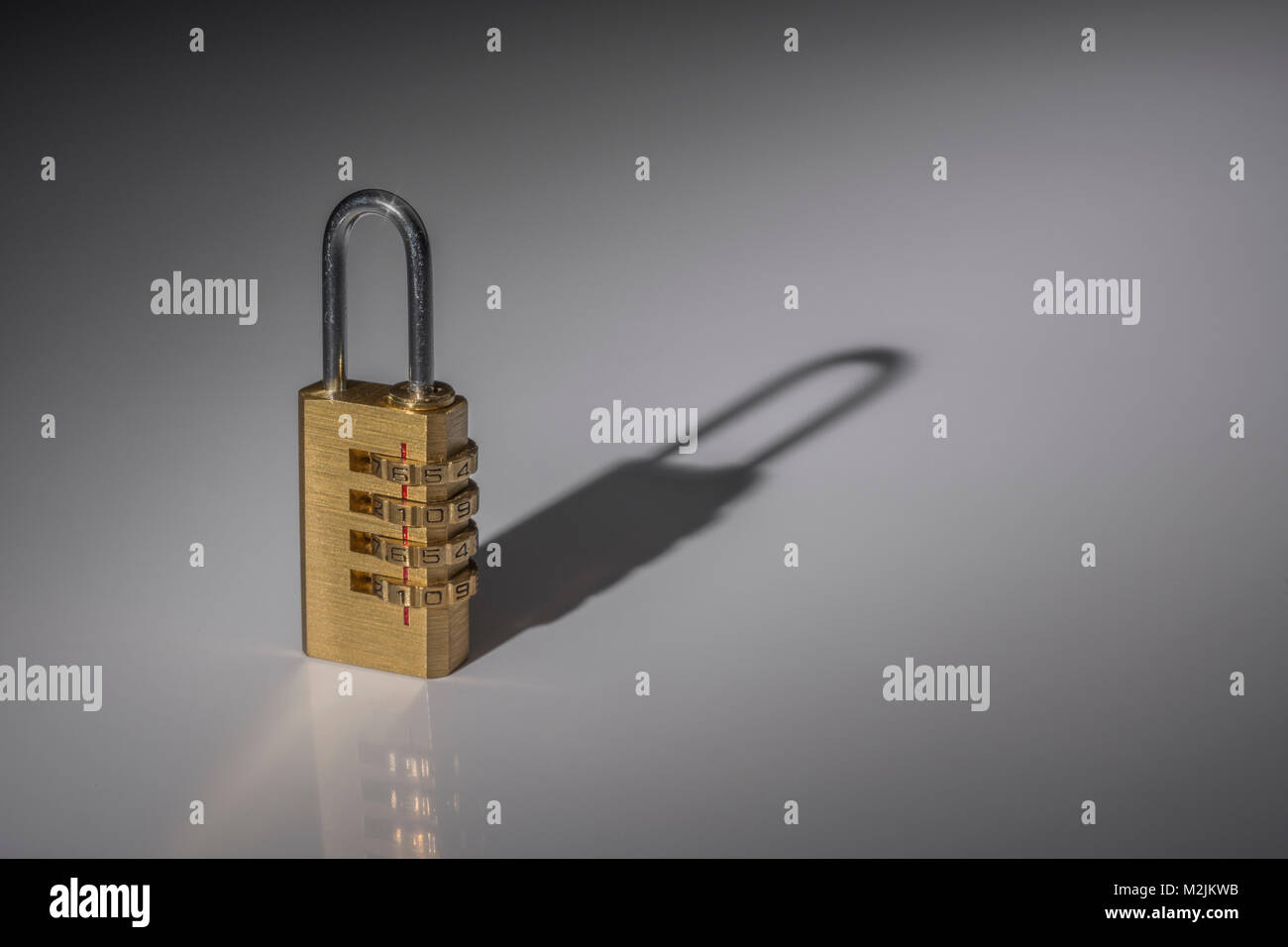 Small combination padlock on plain background - as visual metaphor for concept of data security, email security, - Stock Image
