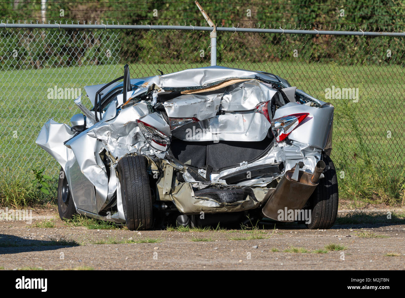 Horizontal shot of a car demolished by a wreck. - Stock Image