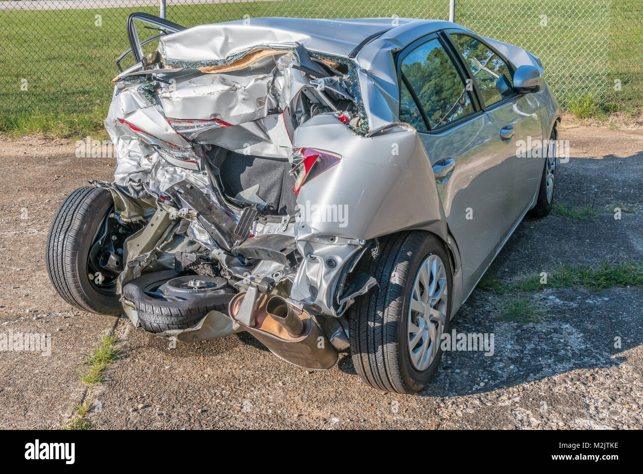 Horizontal shot of a car demolished by a wreck at an angle - Stock Image