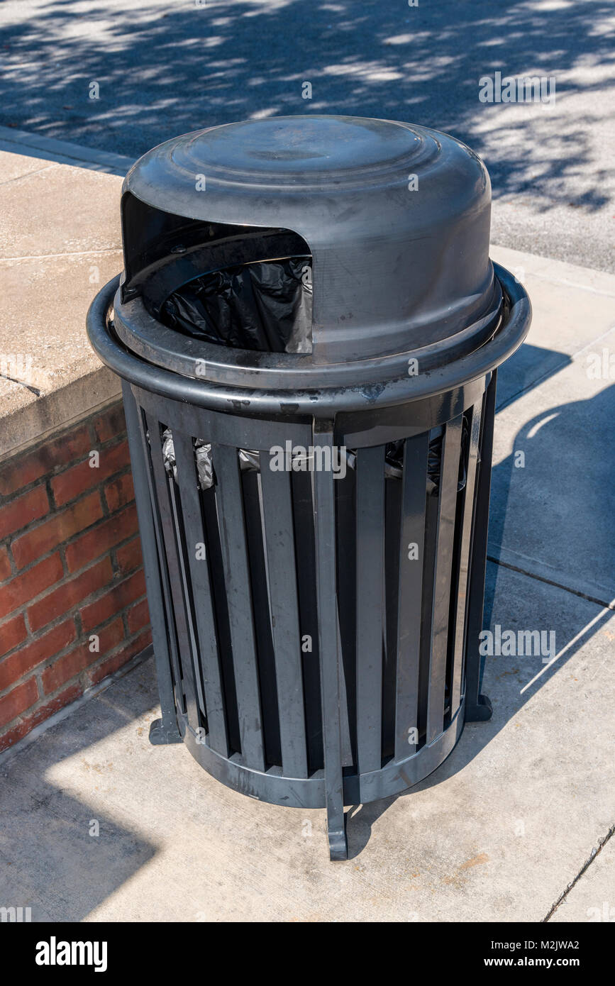 Vertical close-up shot of an outdoor trash receptacle. - Stock Image