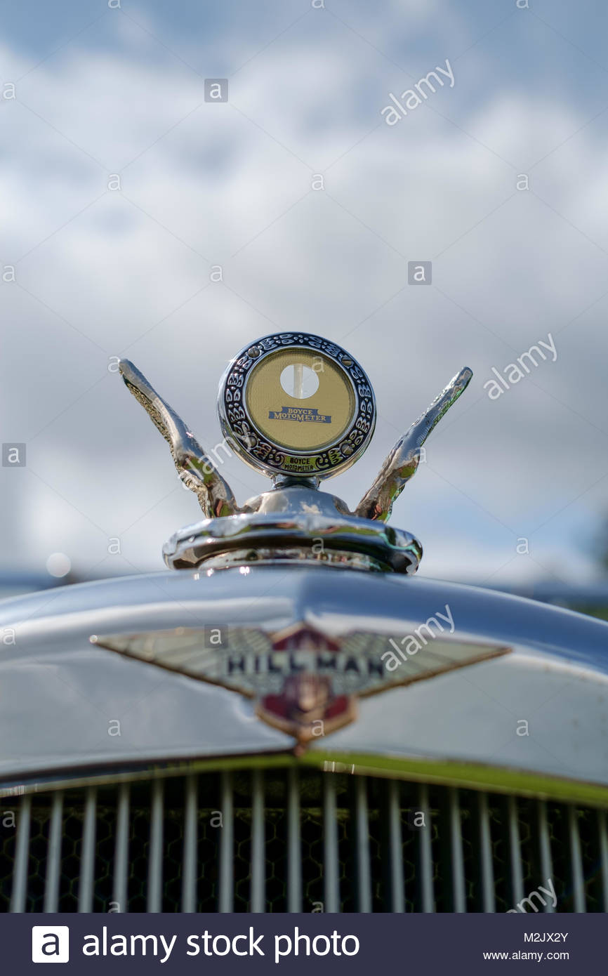 View of Boyce MotoMeter temperature indicator mounted to Hillman historic vehicle at classic car show. West Wales. - Stock Image