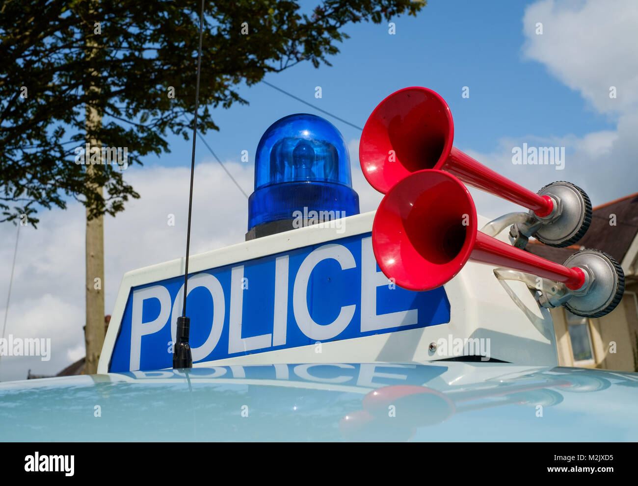 POLICE lettering on illuminated sign and two-tone horns mounted to roof of  Morris Minor classic Police 'Panda' - Stock Image