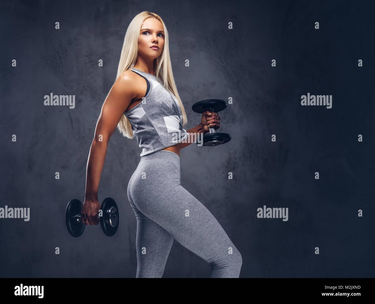 Studio portrait of a sporty woman. - Stock Image