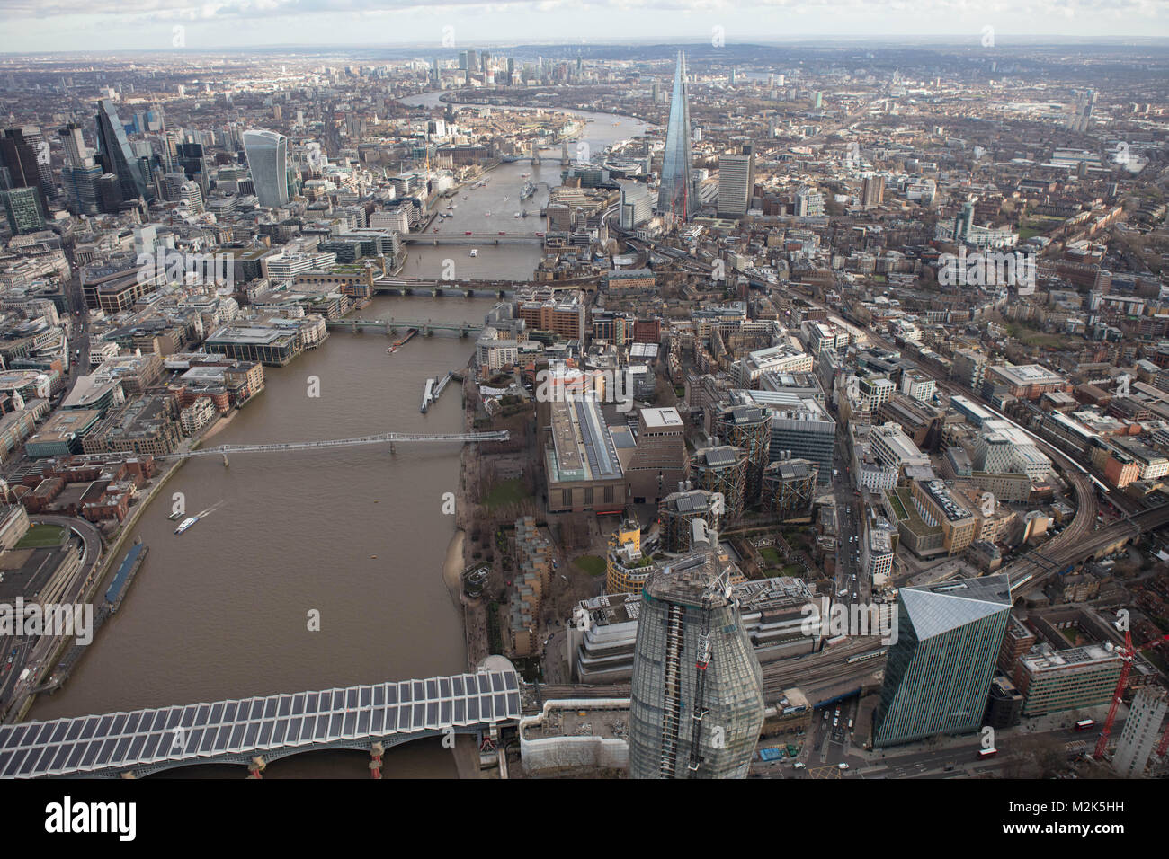 An aerial view of London looking East down the River Thames from Blackfriars Bridge with Canary Wharf visible in - Stock Image