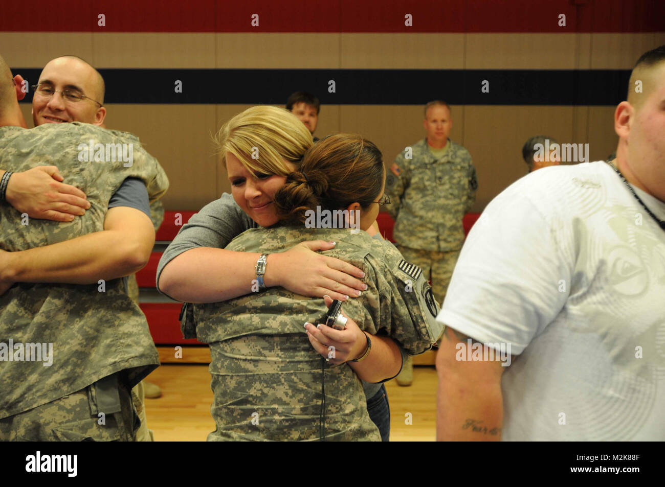 Spc. Melinda Martinez gets a tearful hug from Mrs. Torey Burnett at a welcome home ceremony at Fort Hood for the - Stock Image