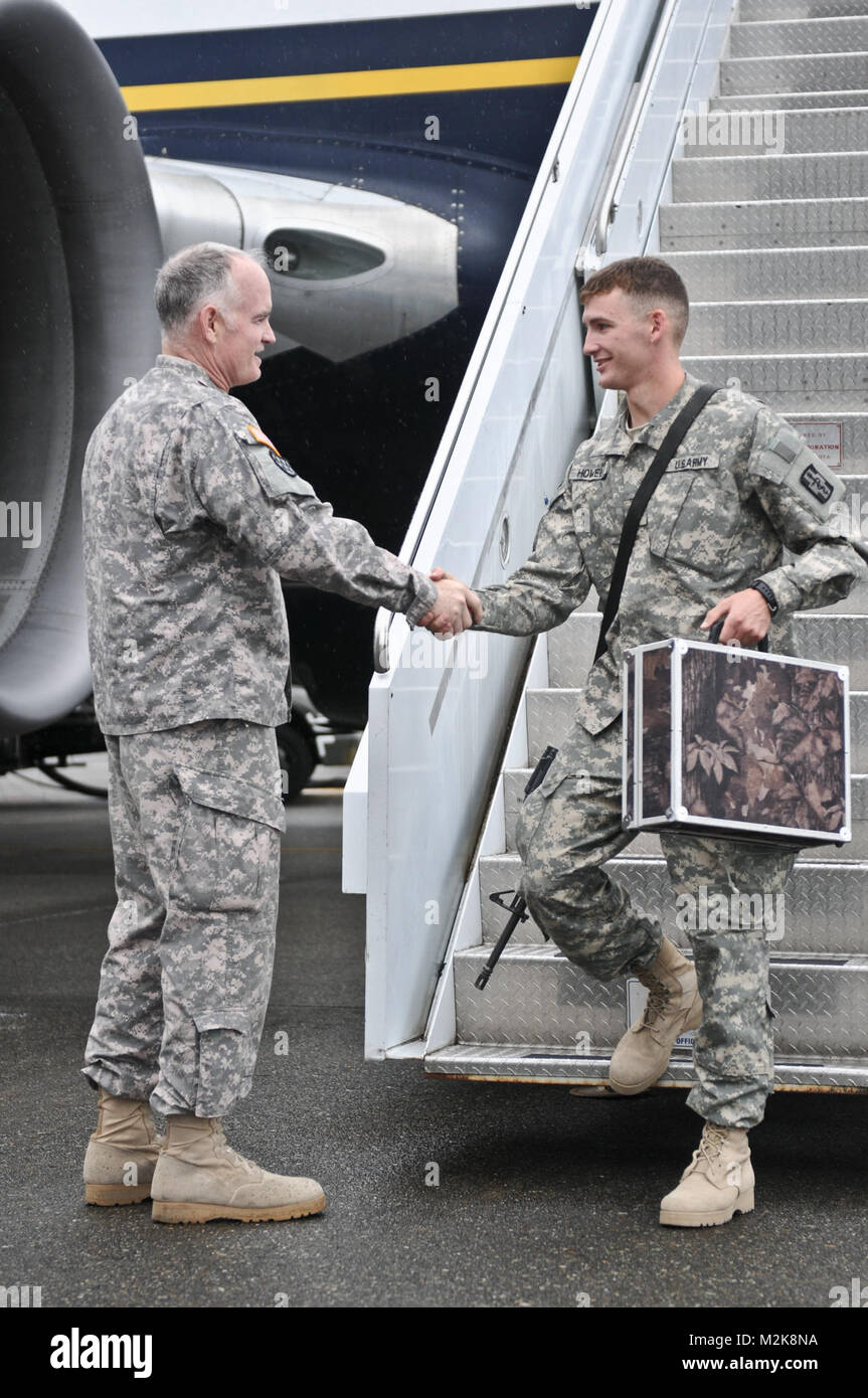 Maj. Gen. Charles A. Anderson greets Sgt. Michael Howell from the 467th Combat Stress Control Detachment as he returned - Stock Image