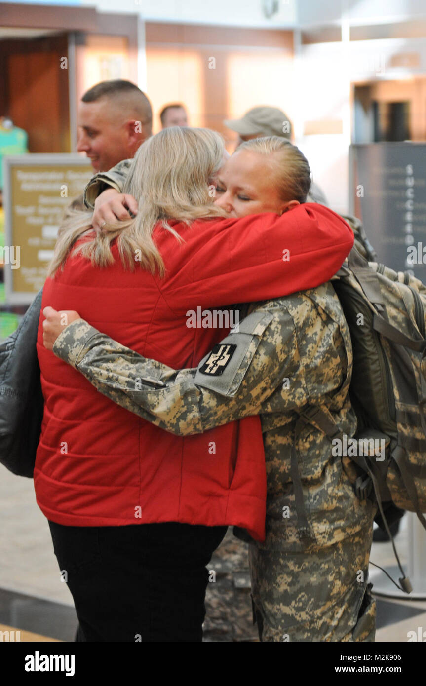 1st Lt. Amanda Beers hugs her mother Deborah upon her return from a year-long deployment to Afghanistan on Oct. - Stock Image