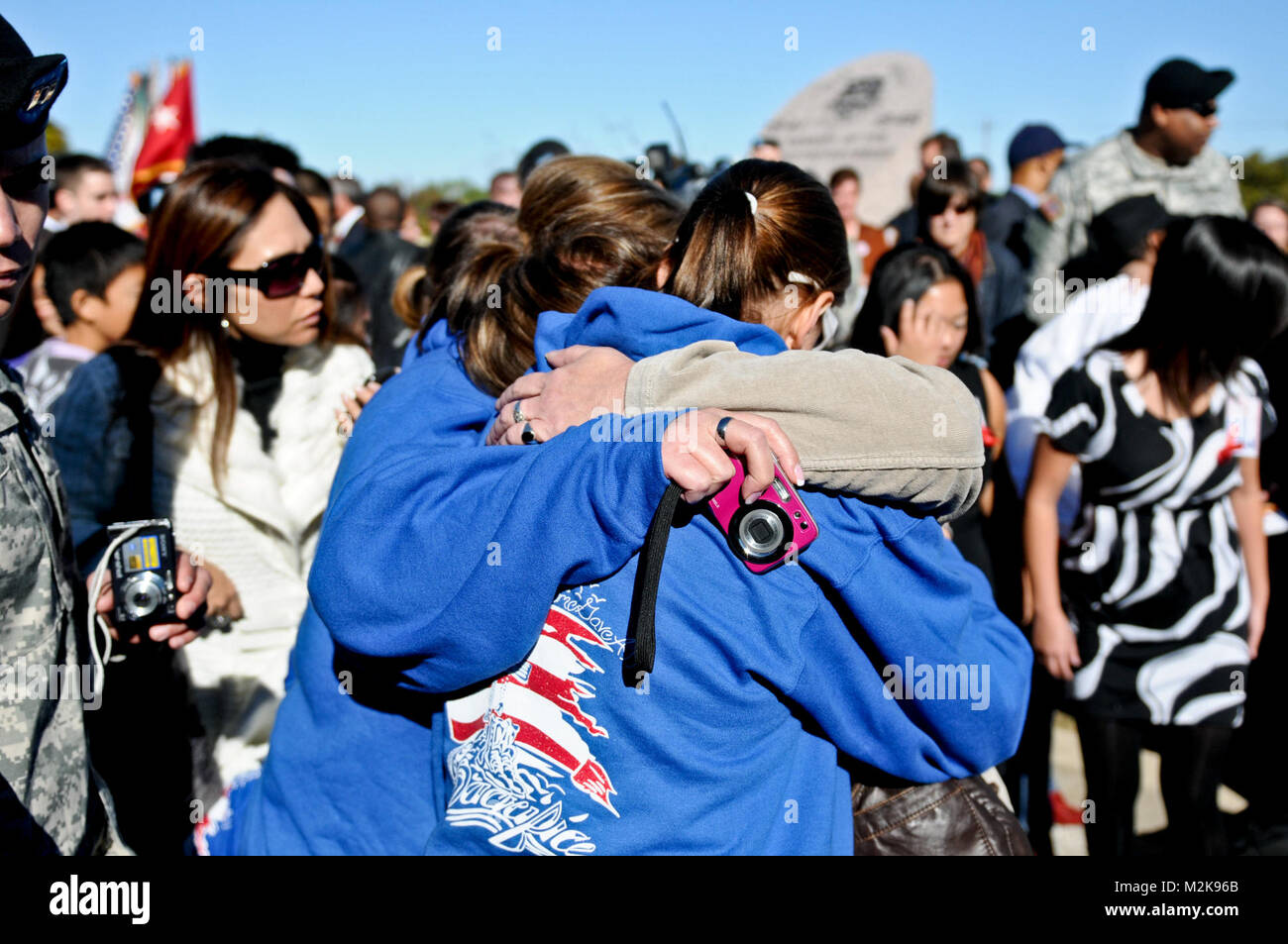 FORT HOOD, Texas -- The Kreuger family shares a tearful hug after the Fort Hood Awards Ceremony and Memorial Stone - Stock Image
