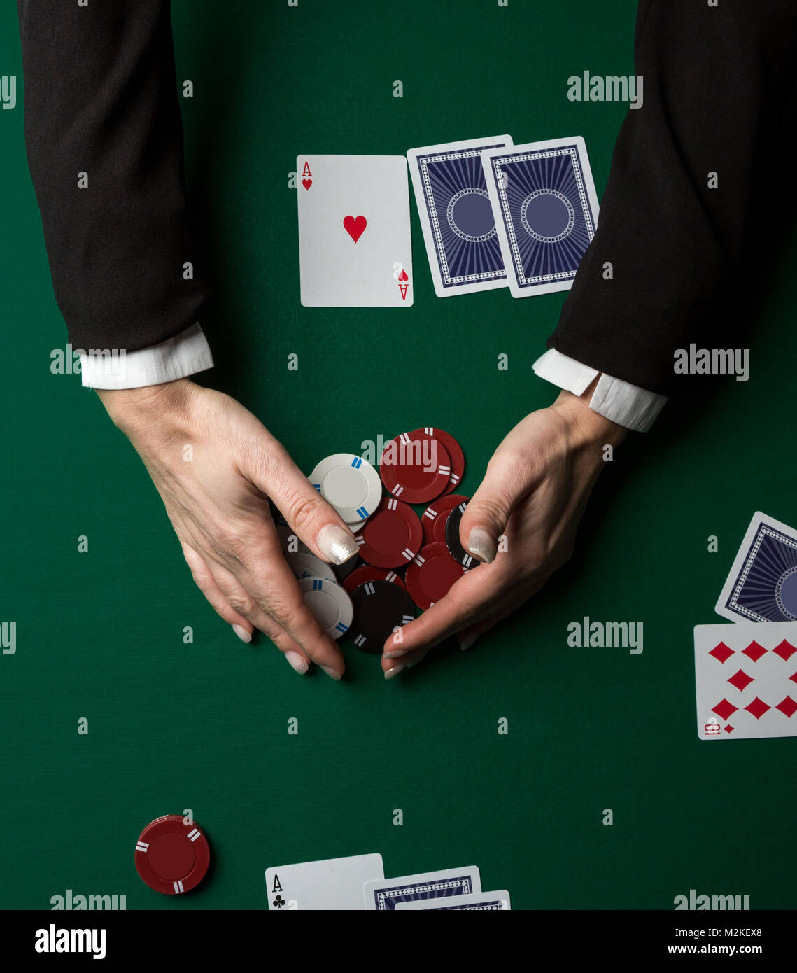 Top view of a poker table during a game.  Chips and cards on the table. - Stock Image