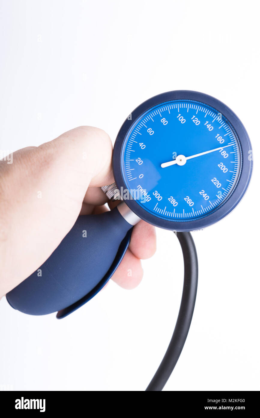 Holding in hand sphygmomanometer isolated on white background - Stock Image
