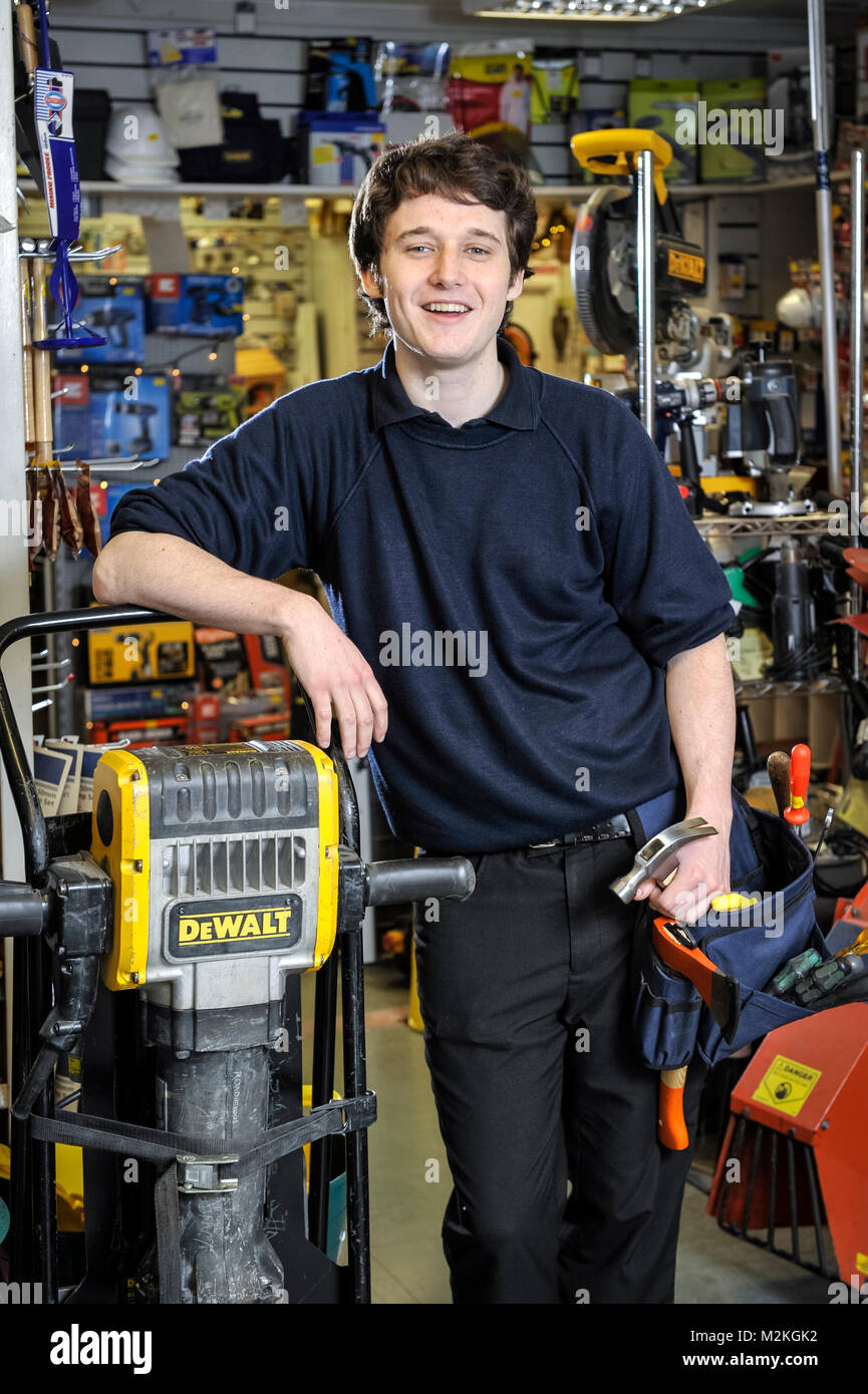 Michael Kenny was a male Norland Nanny and has left to become a hardware store apprentice at a hardware store in - Stock Image